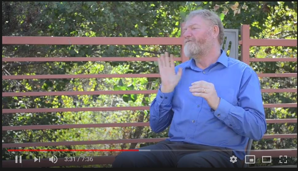 joseph halcott outside in san diego telling a story in american sign language